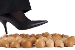 Walking on egg shells. Royalty Free Stock Photography