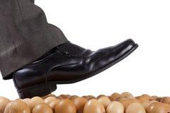 Walking on egg shells. Stock Photos