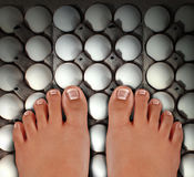 Walking On Eggs Stock Images