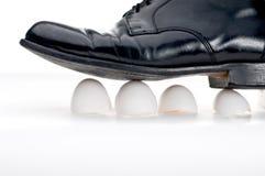 Walking on eggshells Stock Photography