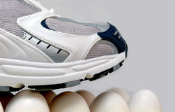Walking on eggshells Stock Images