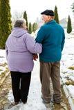 Walking elderly couple royalty free stock photography