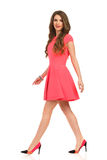 Walking Elegnat Woman In Pink Mini Dress Ans High Heels Stock Photography