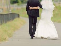 Walking Embracing Couple Stock Images