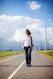 Walking empty road Stock Images