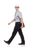 Walking engineer with a digital tablet Stock Images
