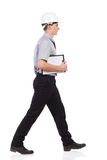 Walking engineer. Royalty Free Stock Image