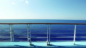 Walking Establishing Shot Looking Over Cruise Ship Railing at Ocean. 8899 A walking tracking daytime establishing shot looking at the open ocean from the deck of stock footage