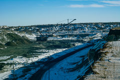 Walking excavator produces manganese ore. Royalty Free Stock Image