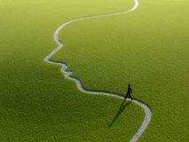Walking on a face-shaped path stock photography