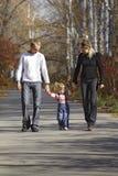 Walking family. In autumn park Stock Photos