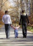 Walking family. In autumn park Stock Photo