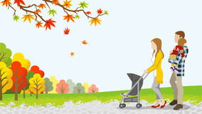 Walking family with Baby Stroller in autumn nature Royalty Free Stock Photos