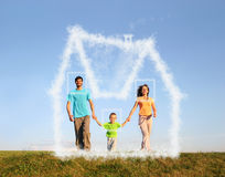 Walking family with boy and dream cloud house. Collage stock photo