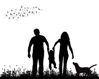 Walking family. Isolated, silhouette family walking on grass, playing Royalty Free Stock Photos