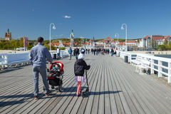 The walking family in Sopot on spring sunny day. Royalty Free Stock Photo
