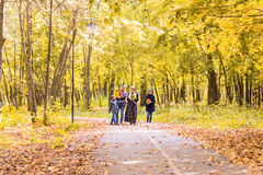 Walking family with three children in autumnal park.  Stock Photo