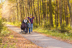 Walking family with two children in autumnal park.  Stock Photo