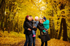 Walking family with two children in autumnal park. Collage Stock Images
