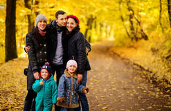 Walking family with two children in autumnal park. Collage Stock Photography