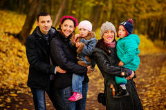Walking family with two children in autumnal park. Collage Royalty Free Stock Photography