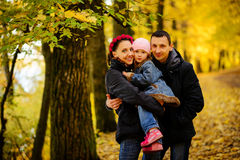 Walking family with two children in autumnal park. Collage Royalty Free Stock Photos