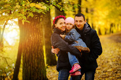 Walking family with two children in autumnal park. Collage Royalty Free Stock Images