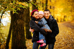 Walking family with two children in autumnal park stock photos