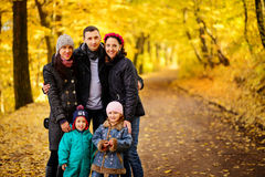 Walking family with two children in autumnal park. Collage Stock Photo