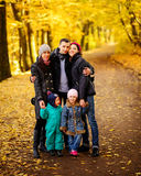 Walking family with two children in autumnal park. Collage Stock Image