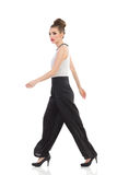 Walking fashion model Royalty Free Stock Photo