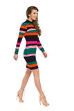 Walking Fashion Model In Striped Mini Dress And High Heels Stock Image