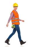 Walking Female Construction Worker Side View Royalty Free Stock Photos