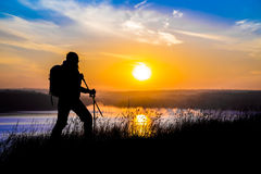 Walking female hiker silhouette and impressive Stock Image