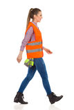 Walking Female Manual Worker Side View Royalty Free Stock Photo