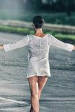 Walking female model wearing a transparent, color Royalty Free Stock Photo