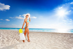 Walking with fins in bag on vacation Royalty Free Stock Photos