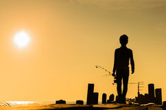 Walking fisherman Royalty Free Stock Photos