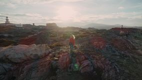Walking on fjords on the edge of world stock video footage