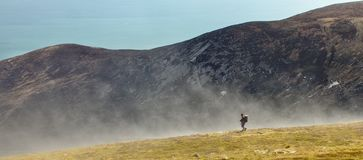 Walking through fog. Person hill walking in the mourne mountains, Co. Down, Northern Ireland Stock Images