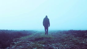 Walking into the fog in slow motion stock video footage