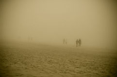 Walking in a foggy morning on the beach of Ostseebad Binz Royalty Free Stock Image