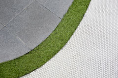 Walking foot path with green grass and tiles background texture Stock Photos