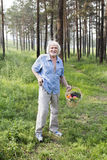 Walking in the forest of elderly man Stock Image