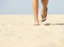 Walking forward in flip flops on beach Stock Photography