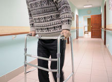 Walking frame. Man moves by zimmer frame Stock Photography