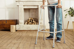 Walking frame being in use. Professional equipment. Close up of a modern walking frame being used by elderly people for moving around Stock Photos