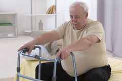 WALKING FRAME SENIOR MAN Stock Image