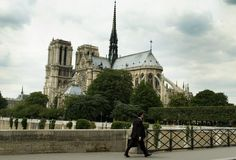 Walking in front of Notre Dame. Busisness man walking in front of Notre Dame Royalty Free Stock Photo