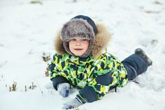 Free Walking Funny Little Boy In The Winter. Child Outdoors. Royalty Free Stock Image - 165920746